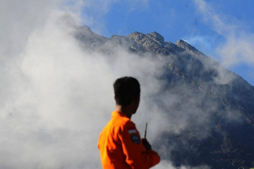 An officer from the National Search and Rescue Agency looks at Mount Merapi following a series of minor eruptions in Selo, Central Java, Indonesia, on May 22, 2018.