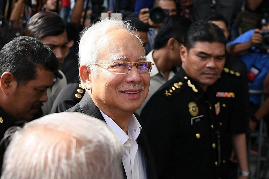 Malaysia's former prime minister Najib Razak (centre) arrives at the Malaysian Anti-Corruption Commission office in Putrajaya, Malaysia, on May 24, 2018.