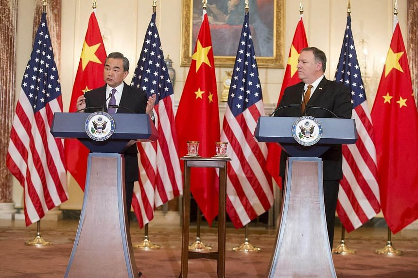 US Secretary of State Mike Pompeo (right) and Chinese Foreign Minister Wang Yi hold a news conference at the beginning of their meeting, in the Ben Franklin Room at the State Department in Washington, DC, on May 23, 2018.