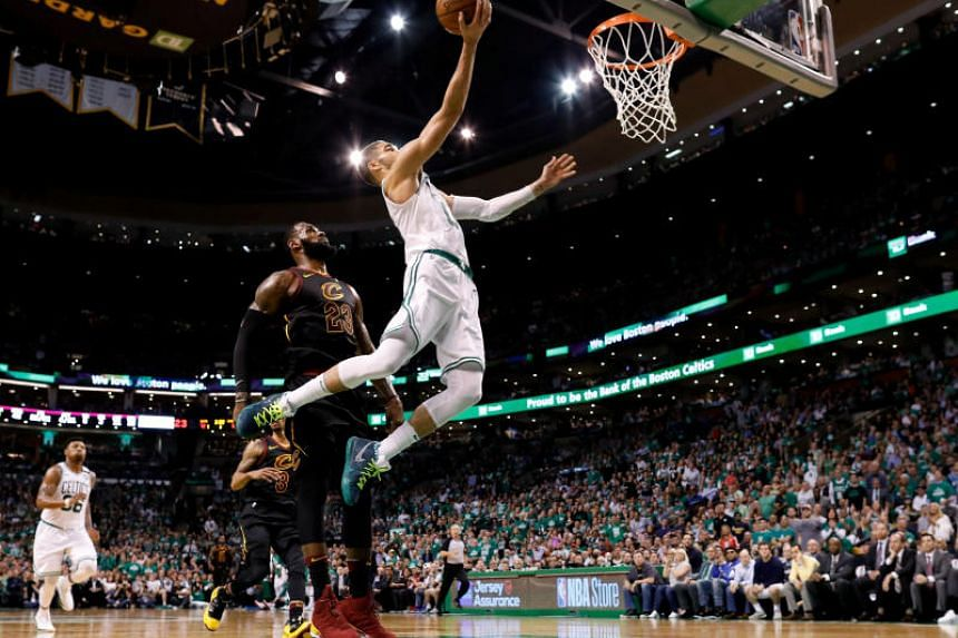 Boston Celtics' Jayson Tatum attempts a layup during 