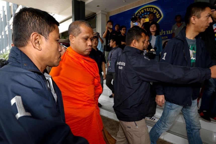An unidentified assistant abbot of Golden Mount Temple is escorted by police officers at the Thai Police Crime Suppression Division headquarters in Bangkok, Thailand, on May 24, 2018.