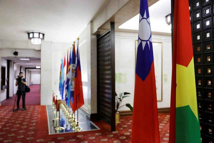 Flags of Taiwan and Burkina Faso (far right) are seen inside the Taiwan's Ministry of Foreign Affairs in Taipei, Taiwan, on May 24, 2018.
