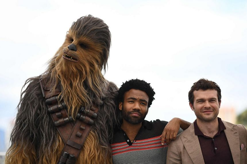Solo: A Star Wars Story stars Joonas Suotamo as Chewbacca (left), Alden Ehrenreich (right) as Han Solo and Donald Glover (centre) as Lando Calrissian.