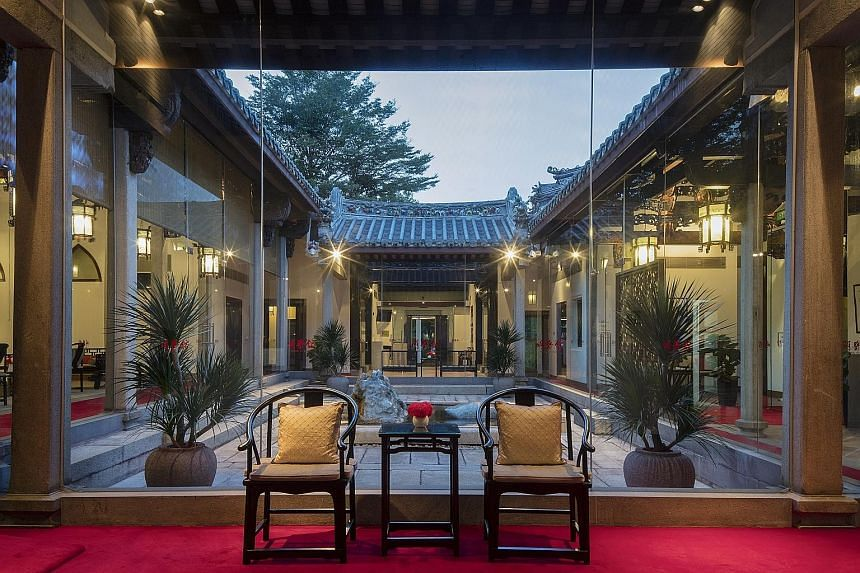 The waiting lounge overlooking the courtyard at Ming Yi Guan, which opened last year on the site as Beijing Hospital of TCM's first treatment facility outside China. The House of Tan Yeok Nee, gazetted as a national monument in 1974, was built in the