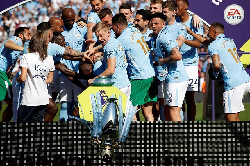 Above: Tom Glick, the chief financial officer of the City Football Group, says a significant part of its focus lies in engaging fans and partners in local communities. Left: Manchester City's Oleksandr Zinchenko looks aghast as the English Premier Le