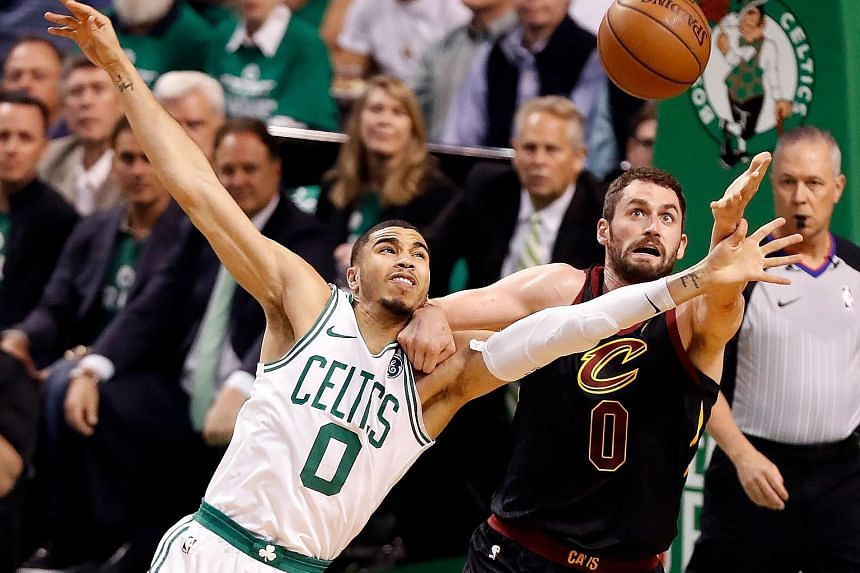 Boston's Jayson Tatum and Cleveland's Kevin Love reaching for the ball during Game 5 of the Eastern Conference Finals. The Celtics won 96-83 and are a win away from the NBA Finals.