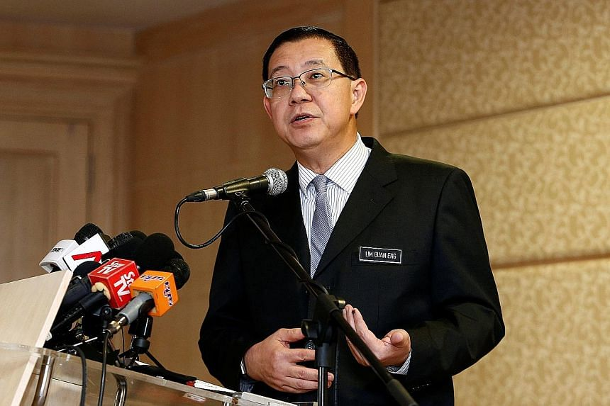 Finance Minister Lim Guan Eng at a news conference in Putrajaya yesterday, where he gave a breakdown of the debts the Malaysian government had incurred under the previous administration.