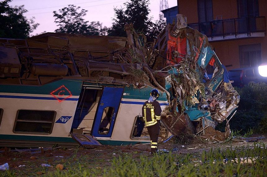 The twisted wreckage of the train that ploughed into a truck outside Caluso near Turin, Italy, late on Wednesday. Two people died and 20 were hurt.