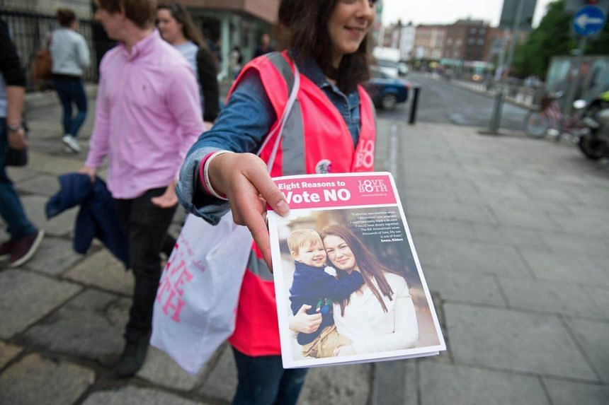 Campaigners for the Love Both pro-life campaign canvass members of the public, urging people to vote 'no' in the referendum to repeal the eighth amendment of the Irish constitution, in Dublin, on May 24, 2018.
