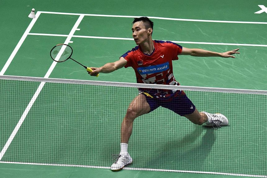 Lee Chong Wei hits a return during his men's singles quarterfinals match at the Thomas and Uber Cup in Bangkok, on May 24, 2018.