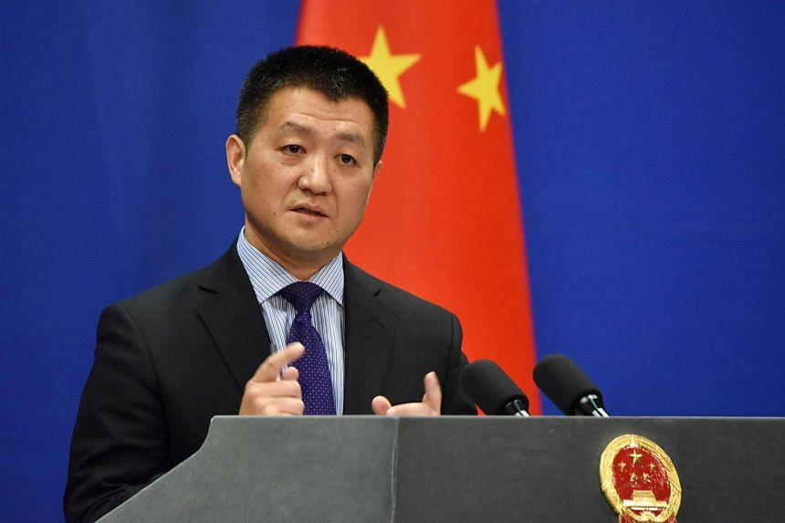"""China has """"indisputable sovereignty"""" over islands in the South China Sea, and it is unrealistic for the US to use such actions to try and coerce it, Foreign Ministry spokesman Lu Kang said."""