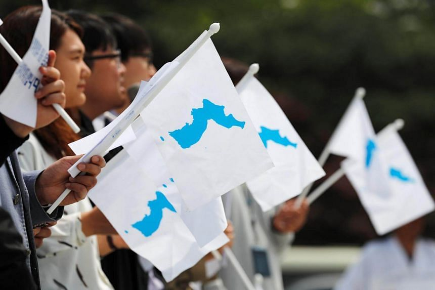 Students hold Korean Unification Flags during a pro-unification rally in Seoul, South Korea, on April 26, 2018.