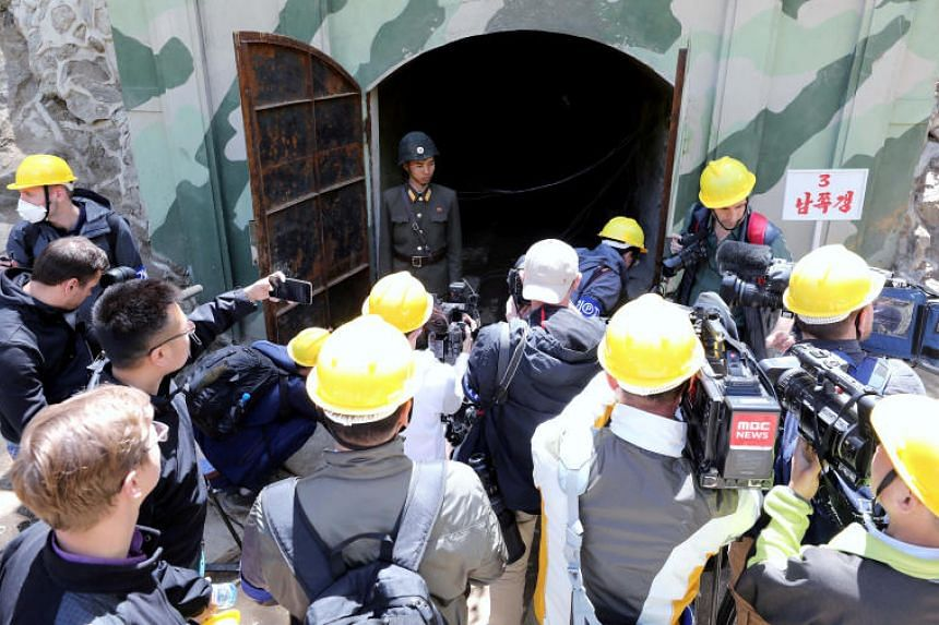 Journalists look around the 3rd tunnel of Punggye-ri nuclear test ground before it is blown up during the dismantlement process in Punggye-ri on May 24, 2018.