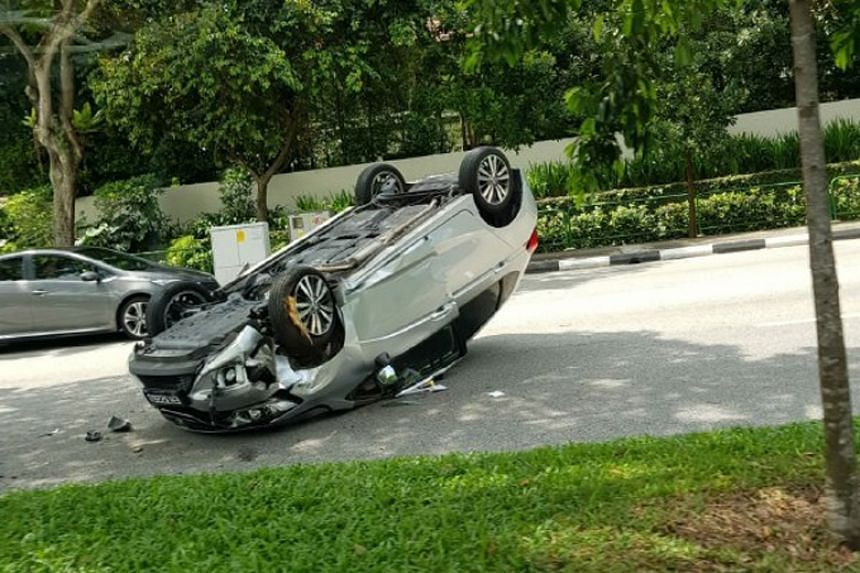Photos circulating online show the silver vehicle lying upside down on the road.
