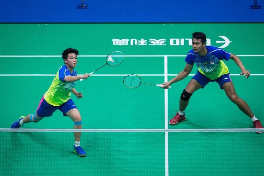 Tontowi Ahmad (right) and Liliyana Natsir of Indonesia during their mixed doubles final match against China at the 2018 Badminton Asia Championships in Wuhan, central China's Hubei province, on April 29, 2018.