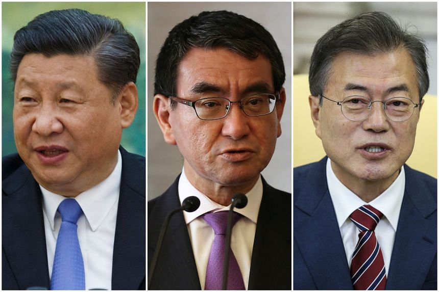 (From left) Chinese President Xi Jinping,  Japanese Foreign Minister Taro Kono and South Korean President Moon Jae In, who was apparently blind-sided by US President Donald Trump's announcement on the summit's cancellation.