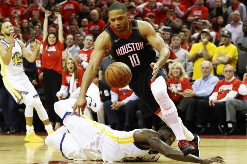 The Houston Rockets' Eric Gordon steals the ball from the Golden State Warriors' Draymond Green late during game five of the Western Conference Finals of the 2018 NBA Playoffs at Toyota Center in Houston on May 24, 2018.