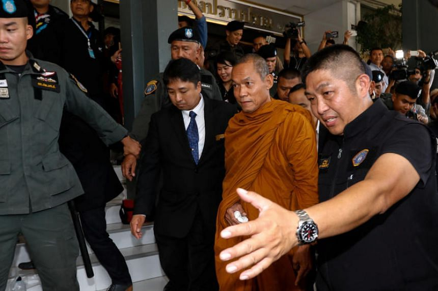 Luang Pu Buddha Issara, 62, an activist monk, being escorted by police officers at the Thai Police Crime Suppression Division headquarters in Bangkok, Thailand, on May 24, 2018.
