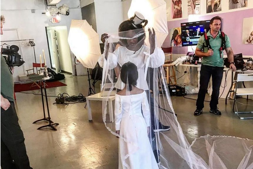 Seven-year-old Naiyah Otero wore a version of Markle's boat-necked Givenchy wedding gown as interpreted by Esaie Couture.