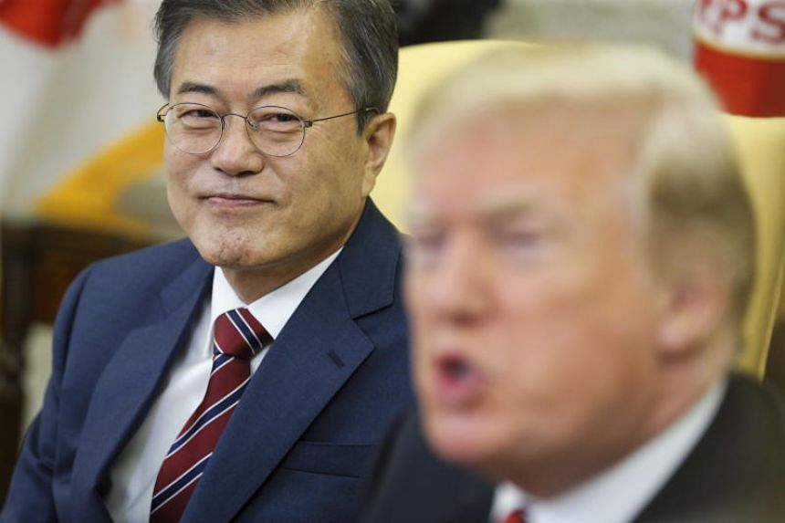 South Korean President Moon Jae In (left) listens during a meeting with US President Donald Trump in the Oval Office of the White House in Washington, DC, on May 22, 2018.
