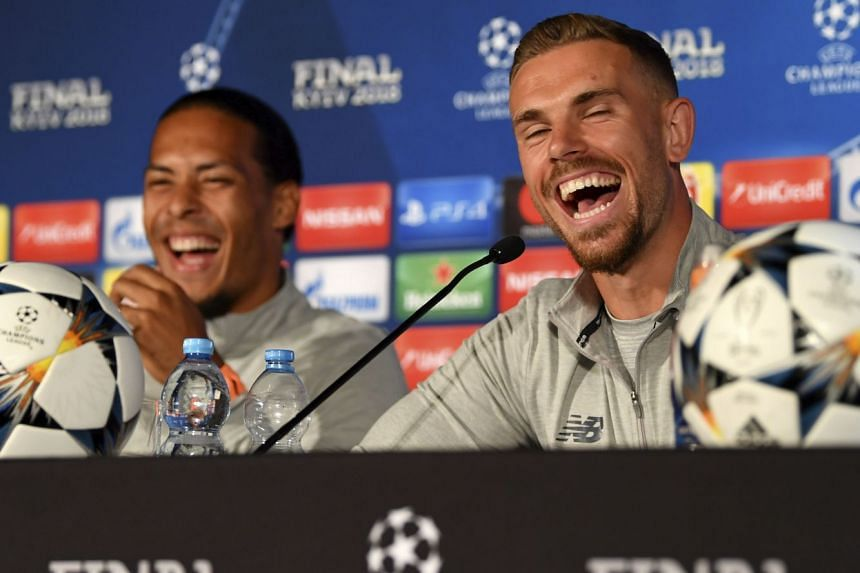 Liverpool's Virgil van Dijk (left) and Jordan Henderson at a press conference in Kiev, Ukraine.