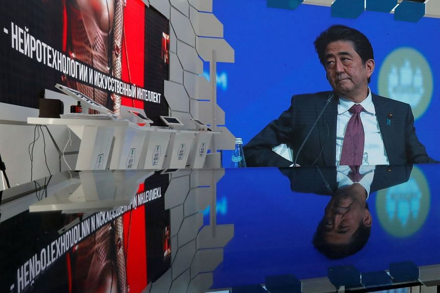 Abe is seen on a screen during a session of the St Petersburg International Economic Forum.