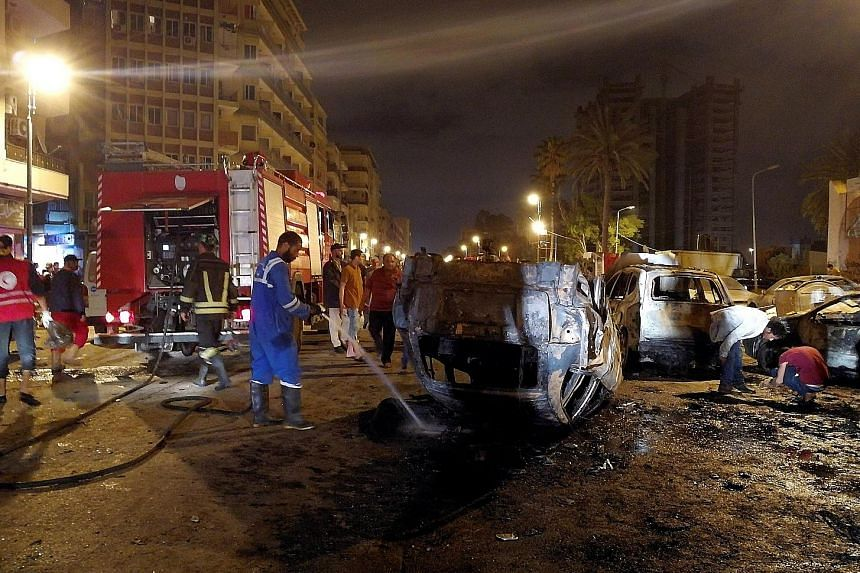 The aftermath of the car bombing in Benghazi on Thursday night, which took place close to the Tibesti hotel on a busy road where many people go to celebrate during the month of Ramadan. No group has yet claimed responsibility for the attack.