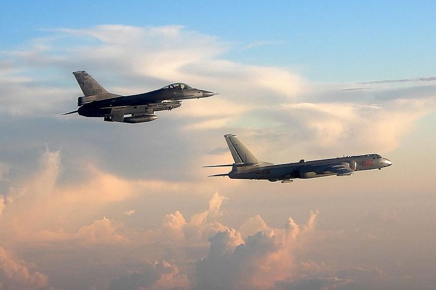 A Taiwanese F-16 fighter jet (left) monitoring one of two Chinese H-6 bombers that flew over the Bashi Channel south of Taiwan and the Miyako Strait, near Japan's Okinawa Island, yesterday.