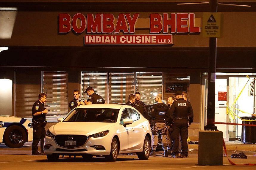 Police outside Bombay Bhel restaurant, where two unidentified men set off a bomb on Thursday night, wounding 15 people, in Mississauga, Ontario. Three of the victims had critical injuries. No one has claimed responsibility, and the motive for the att