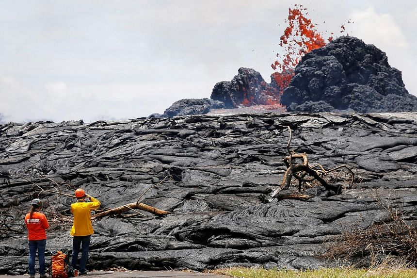 Lava erupting from a fissure in the Leilani Estates near Pahoa, Hawaii, earlier this week. On Thursday evening, Kilauea volcano erupted at its summit, sending ash 3,000m into the air.