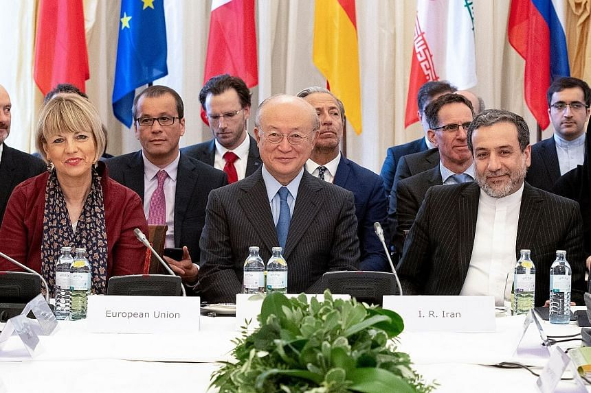 From left: Secretary-general of the European Union External Action Service Helga Schmid, International Atomic Energy Agency's director-general Yukiya Amano and Iran's Deputy Foreign Minister Abbas Araghchi joined British, Chinese, French, German and