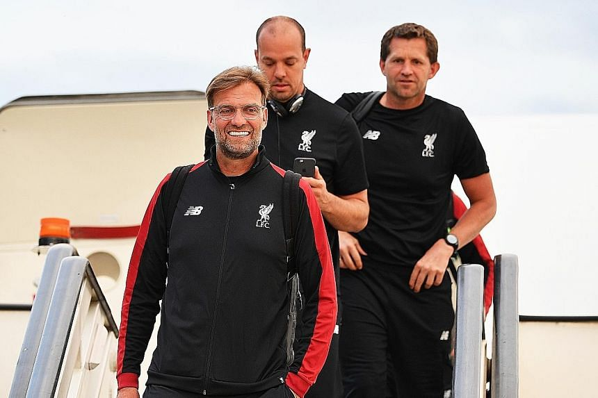 Real Madrid coach Zinedine Zidane and Liverpool manager Jurgen Klopp (above) arriving in Kiev ahead of the Champions League final today. If Real prevail, they will become the first team since Bayern Munich in 1976 to record three consecutive European triu