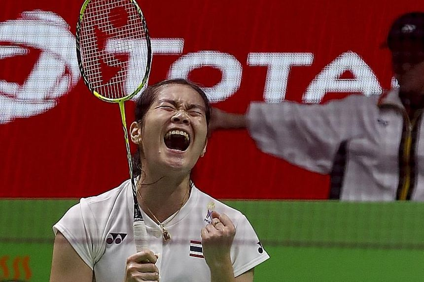Thailand's Busanan Ongbamrungphan shows her joy after defeating China's 2012 Olympic champion Li Xuerui 21-11, 21-9 during their Uber Cup semi-final in Bangkok yesterday. The victory earned Thailand a first final appearance against Japan today.