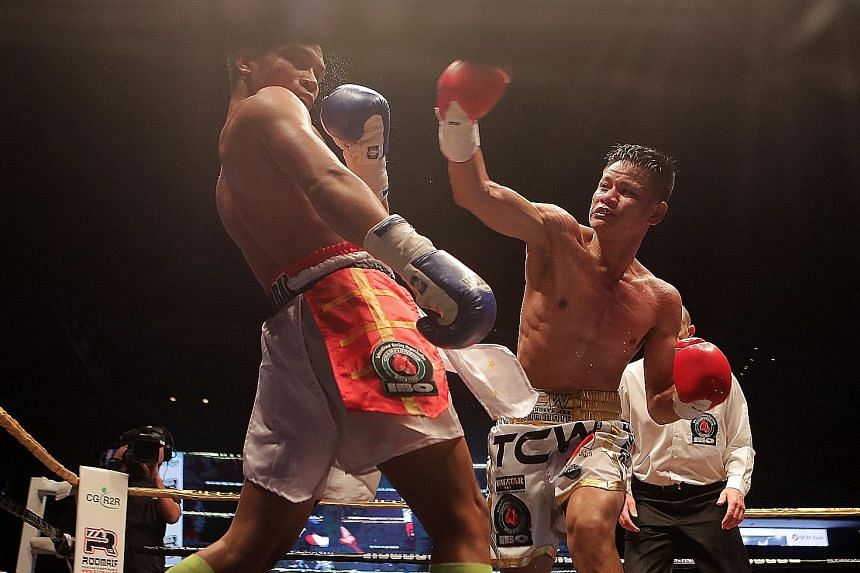 Muhamad Ridhwan landing a right on Filipino Jeson Umbal during his majority win to take the IBO intercontinental featherweight title at the Indoor Stadium last month. The Singaporean wants to be able to retain his power when he moves down to the supe