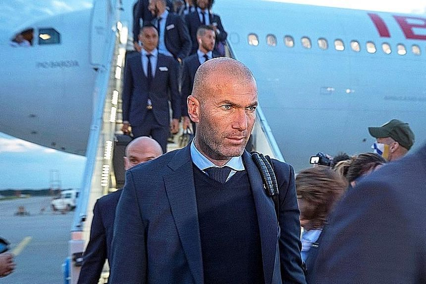 Real Madrid coach Zinedine Zidane (above) and Liverpool manager Jurgen Klopp arriving in Kiev ahead of the Champions League final today. If Real prevail, they will become the first team since Bayern Munich in 1976 to record three consecutive European triu