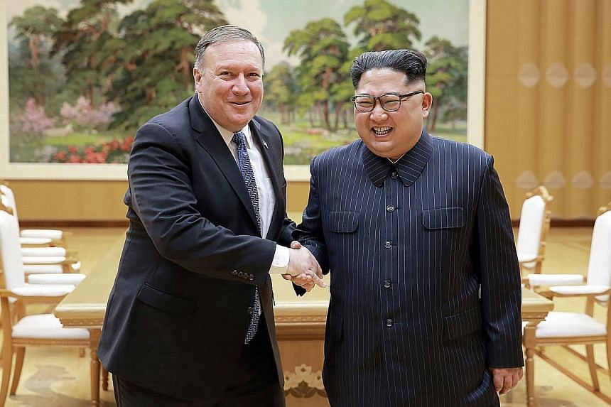 Left: North Korean leader Kim Jong Un and US Secretary of State Mike Pompeo meeting on May 8 at the Workers' Party of Korea headquarters in Pyongyang, in this photo released by North Korea's official Korean Central News Agency (KCNA). Mr Pompeo, who