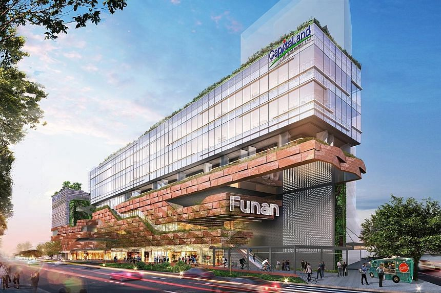 Artist's impressions of the robotic arm (left) at the Funan mall (above), opening next year.