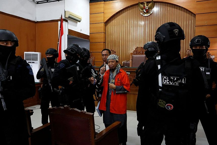 Radical cleric Aman Abdurrahman at a South Jakarta district court yesterday. Security was beefed up ahead of the trial, with police mobilising snipers and setting up a four-ring defence both inside and outside the building.