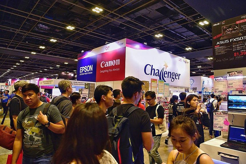 Large crowds are seen scoping out this year's line-up of the latest gadgets and cashing in on discounts of up to 90 per cent at the Consumer Electronics Exhibition.