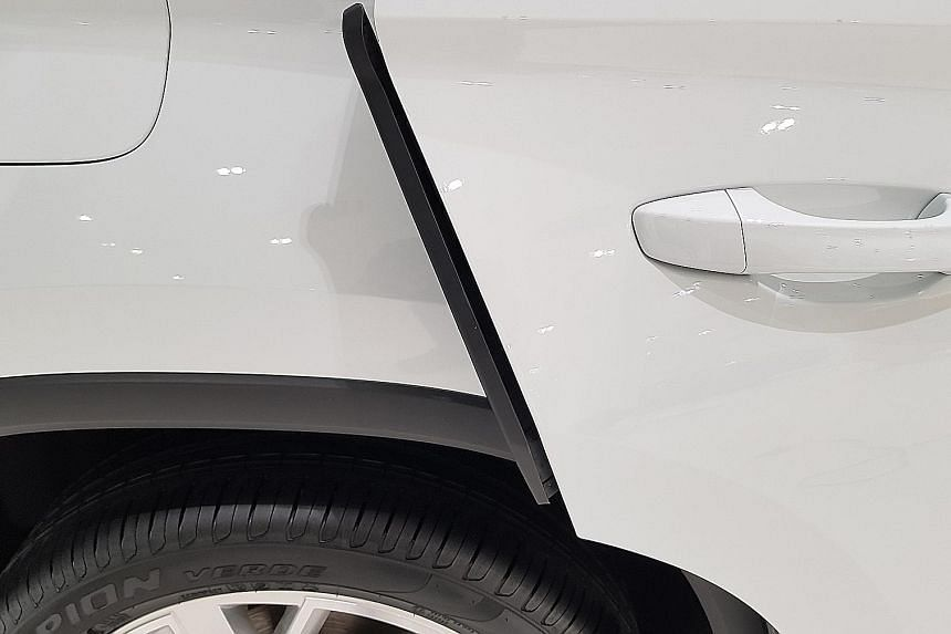 When the doors of the Skoda Kodiaq open, plastic strips snap out to protect the edges and prevent doors from denting cars parked beside it.