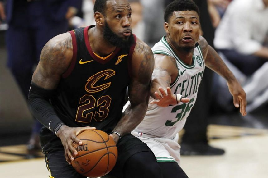 LeBron James (left) of the Cleveland Cavaliers fending off a challenge from Jaylen Brown of the Boston Celtics during a match in Cleveland, Ohio, USA, on May 25, 2018.