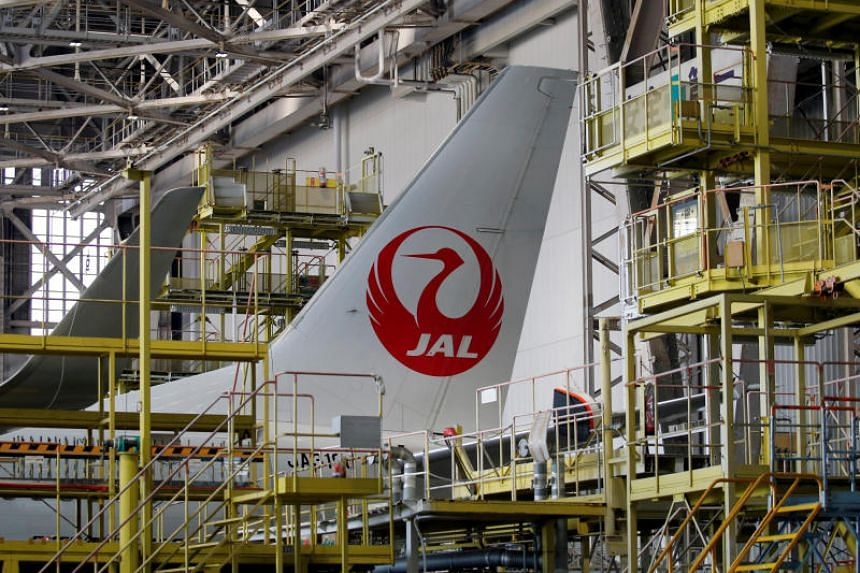 File photo showing a Japan Airlines aircraft at a Haneda Airport hangar in Tokyo, Japan, on April 3, 2017.