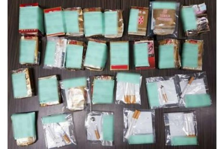 Packs of contraband cigarettes found during the raid at the dormitory in Punggol.