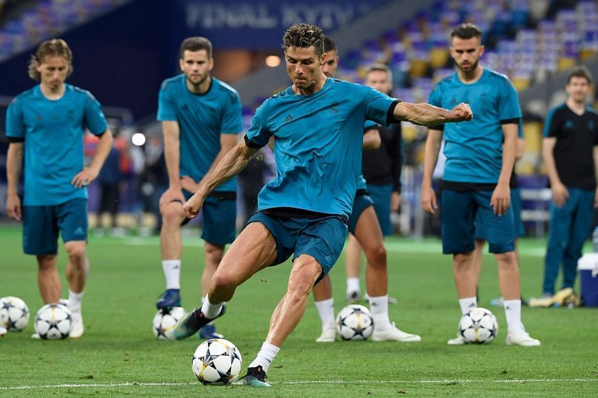 Real Madrid's Cristiano Ronaldo kicks the ball during a team training session in Kiev.
