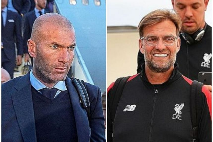 Real Madrid coach Zinedine Zidane (left) and Liverpool manager Jurgen Klopp arriving in Kiev on May 26, 2018, ahead of the Champions League final. If Real Madrid prevail, they will become the first team since Bayern Munich in 1976 to record three con