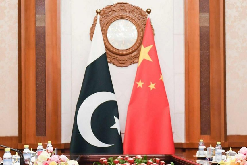 The flags of Pakistan and China seen in a meeting room at the Diaoyutai State Guest House in Beijing on April 23, 2018. Lending to Pakistan by China and its banks is on track to hit US$5 billion in the fiscal year ending in June.