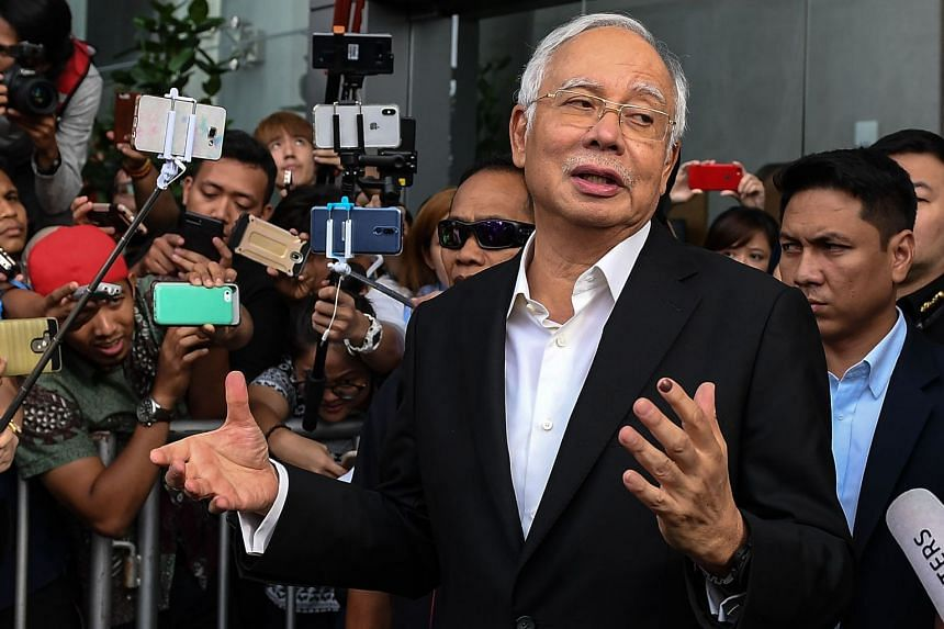 Mr Najib speaking to the media after being questioned at the Malaysian Anti-Corruption Commission in Putrajaya, on May 24, 2018.