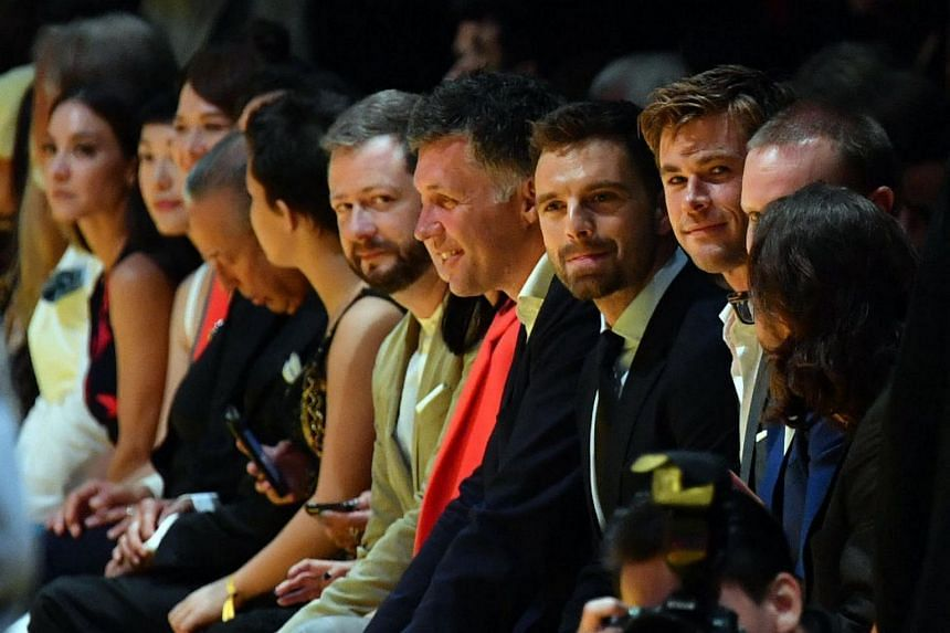 Hollywood stars Chris Hemsworth (extreme right) and Sebastian Stan (second from right) at the Hugo Boss show.