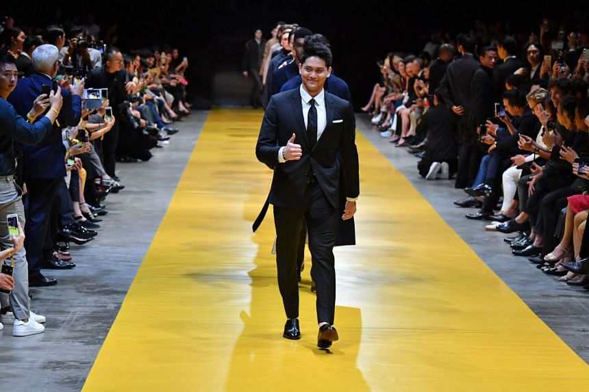Singapore's Olympic star Joseph Schooling walking down the runway during the finale of the Hugo Boss fashion show.