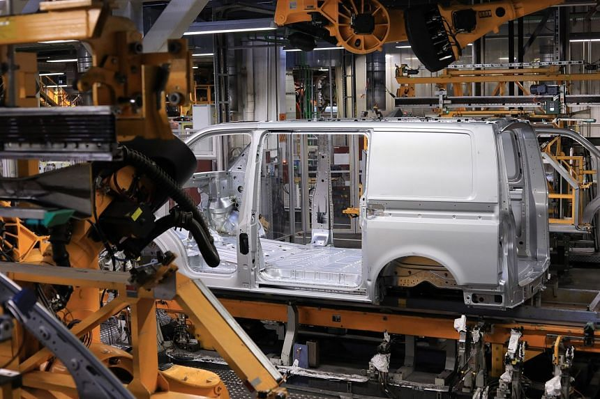 A Transporter T6 panel van body stands on the assembly line at the Volkswagen factory in Hanover, Germany.